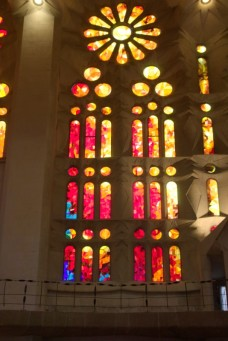 1st look at the inside of the Basilica and my breath was taken away. How the light played inside was unreal. White (creamy) collumns and walls and colorful stained glass windows.