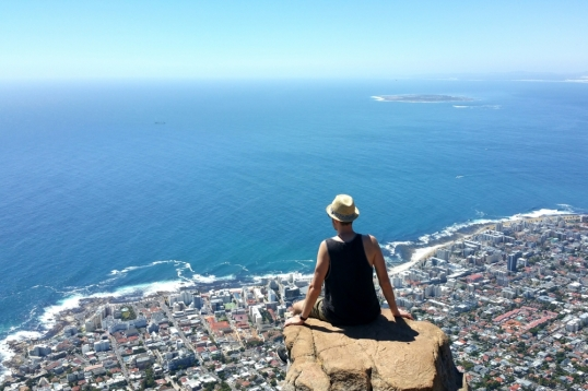 Man on the edge of a rock on Lion's Head, Cape Town, South Africa