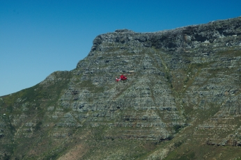 Helicopter for the rescue, lion's head, Cape Town, South Africa, with Table Mountain in the background