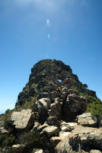narrow path leading to the summit of lions head, busy, beautiful day, rocks,